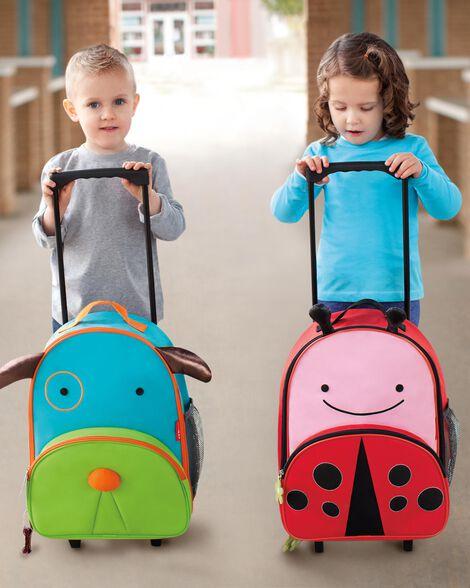 Zoo kids rolling luggage